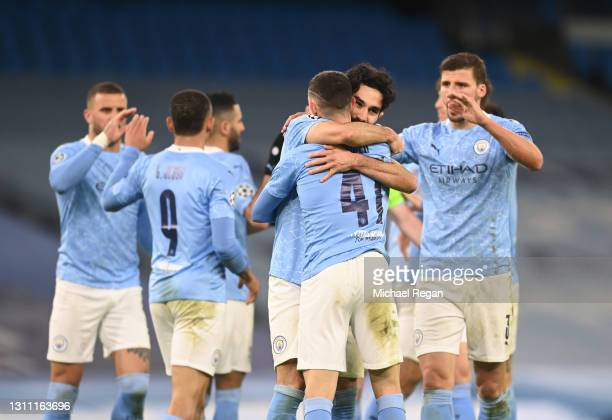 Phil Foden of Manchester City celebrates with teammate Ilkay Guendogan after scoring their team's second goal during the UEFA Champions League...