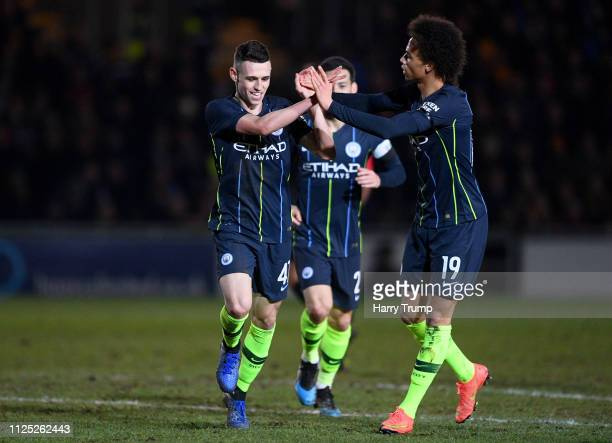 Phil Foden of Manchester City celebrates with teammate Leroy Sane after scoring his team's second goal during the FA Cup Fifth Round match between...