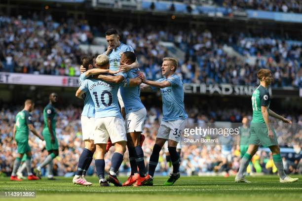Phil Foden of Manchester City celebrates with teammates after scoring his team's first goal during the Premier League match between Manchester City...