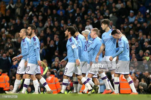 Phil Foden of Manchester City celebrates with teammates after scoring his team's fourth goal during the FA Cup Third Round match between Manchester...