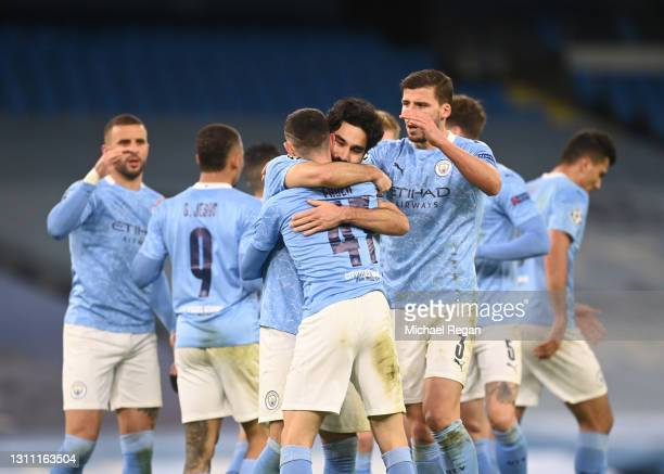 Phil Foden of Manchester City celebrates with teammates Ruben Dias and Ilkay Guendogan after scoring their team's second goal during the UEFA...