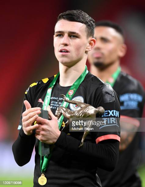 Phil Foden of Manchester City celebrates with the Man of the Match Trophy following his sides victory in the Carabao Cup Final between Aston Villa...