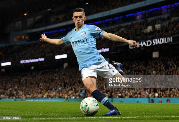 Phil Foden of Manchester City crosses the ball during the Carabao Cup Fourth Round match between Manchester City and Fulham at Etihad Stadium on...