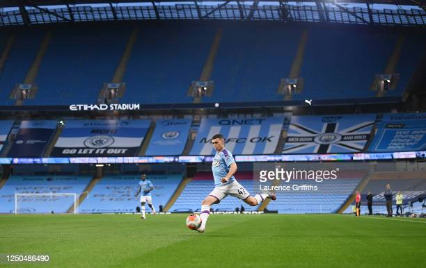 Phil Foden of Manchester City crosses the ball the ball during the Premier League match between Manchester City and Arsenal FC at Etihad Stadium on...