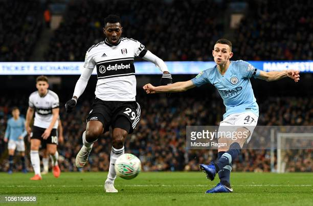 Phil Foden of Manchester City crosses the ball under pressure from AndreFrank Zambo Anguissa of Fulham during the Carabao Cup Fourth Round match...