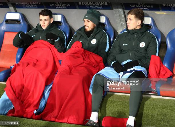 Phil Foden of Manchester City David Silva of Manchester City and John Stones of Manchester City put blankets over them to keep them warm prior to the...