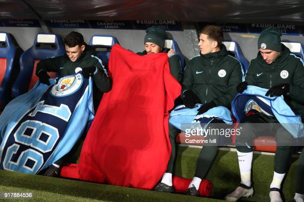 Phil Foden of Manchester City David Silva of Manchester City John Stones of Manchester City and Aymeric Laporte of Manchester City put blankets over...