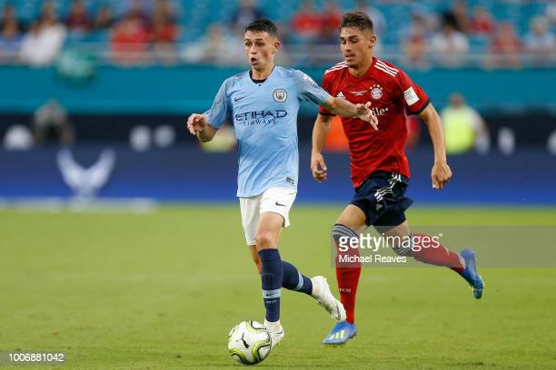 Phil Foden of Manchester City dribbles with the ball against Bayern Munich in the first half during the International Champions Cup at Hard Rock...