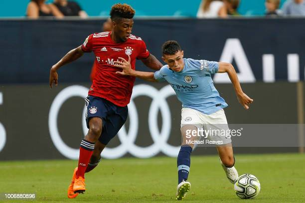 Phil Foden of Manchester City dribbles with the ball defended by Kingsley Coman of Bayern Munich in the second half of the International Champions...