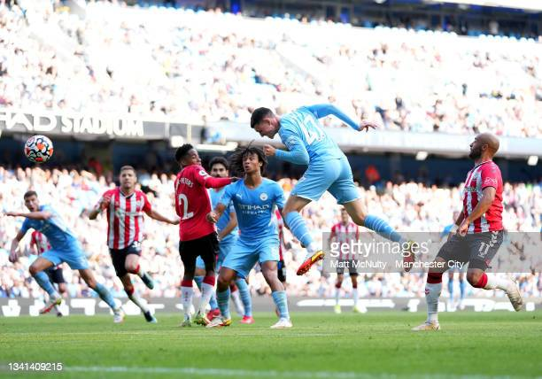 Phil Foden of Manchester City fires a header at goal during the Premier League match between Manchester City and Southampton at Etihad Stadium on...