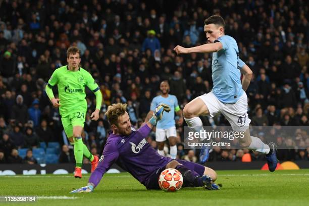 Phil Foden of Manchester City goes round Ralf Faehrmann of FC Schalke 04 to scores his team's sixth goal during the UEFA Champions League Round of 16...