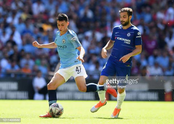 Phil Foden of Manchester City holds off Cesc Fabregas of Chelsea during the FA Community Shield between Manchester City and Chelsea at Wembley...