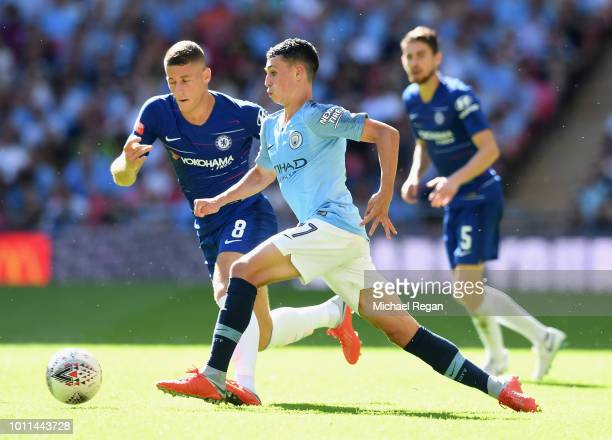 Phil Foden of Manchester City holds off Ross Barkley of Chelsea during the FA Community Shield between Manchester City and Chelsea at Wembley Stadium...