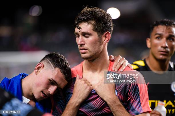 Phil Foden of Manchester City hugs John Stones of Manchester City during the preseason friendly match between Kitchee and Manchester City at the Hong...