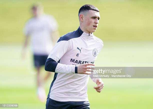 Phil Foden of Manchester City in action during a training session at Manchester City Football Academy on April 13, 2021 in Manchester, England.