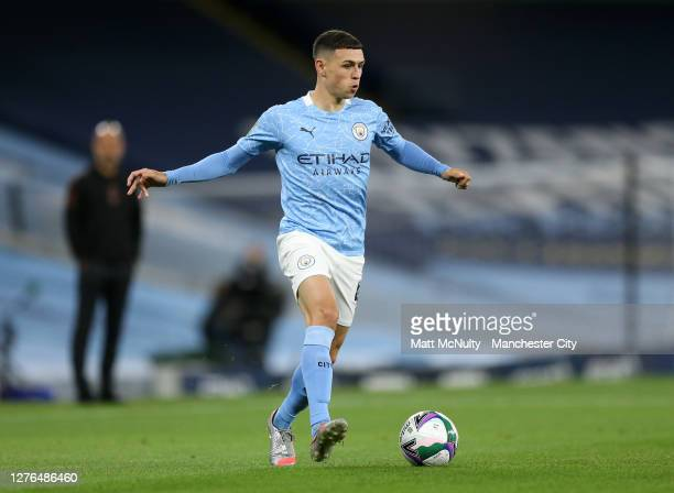Phil Foden of Manchester City in action during the Carabao Cup third round match between Manchester City and AFC Bournemouth at Etihad Stadium on...