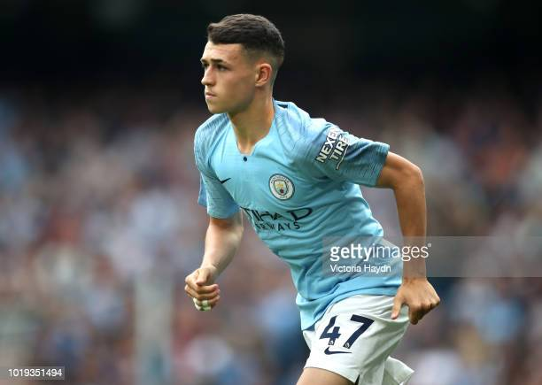 Phil Foden of Manchester City in action during the Premier League match between Manchester City and Huddersfield Town at Etihad Stadium on August 19...
