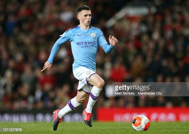 Phil Foden of Manchester City in action during the Premier League match between Manchester United and Manchester City at Old Trafford on March 08...