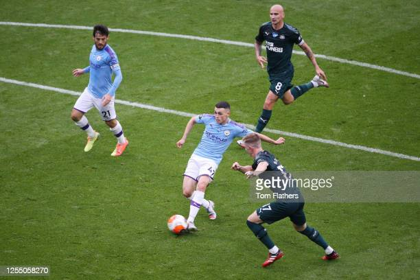 Phil Foden of Manchester City in action during the Premier League match between Manchester City and Newcastle United at Etihad Stadium on July 08,...