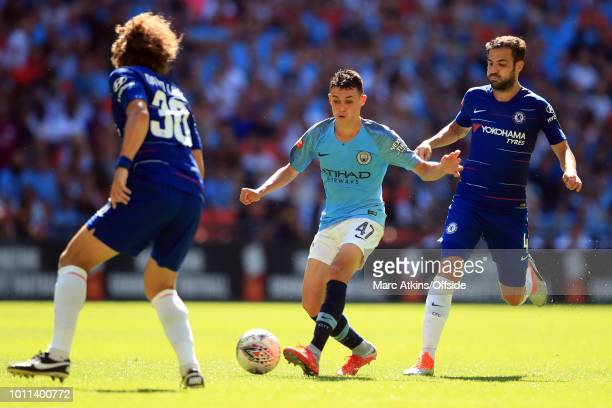 Phil Foden of Manchester City in action with Cesc Fabregas and David Luiz of Chelsea during the FA Community Shield between Manchester City and...