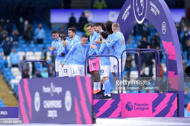 Phil Foden of Manchester City is applauded onto the podium after the Premier League match between Manchester City and Everton at the Etihad Stadium...