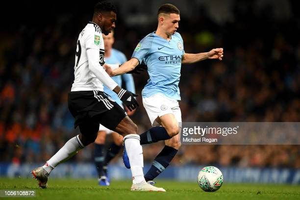 Phil Foden of Manchester City is challenged by AndreFrank Zambo Anguissa of Fulham during the Carabao Cup Fourth Round match between Manchester City...