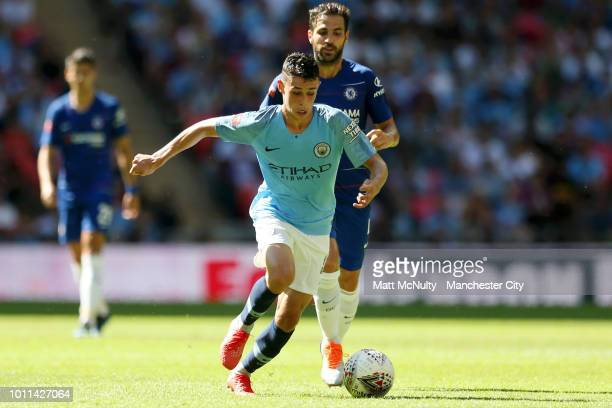 Phil Foden of Manchester City is challenged by Cesc Fabregas of Chelsea during the FA Community Shield between Manchester City and Chelsea at Wembley...