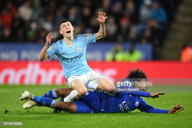Phil Foden of Manchester City is challenged by Hamza Choudhury of Leicester City during the Carabao Cup Quarter Final match between Leicester City...