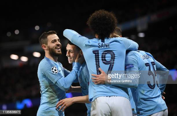 Phil Foden of Manchester City is congratulated by Bernardo Silva and Leroy Sane after scoring the sixth goal during the UEFA Champions League Round...
