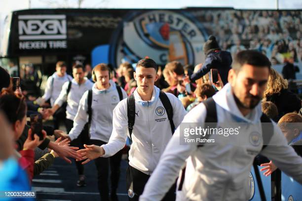 Phil Foden of Manchester City is greeted by fans as he arrives prior to the Premier League match between Manchester City and Crystal Palace at Etihad...