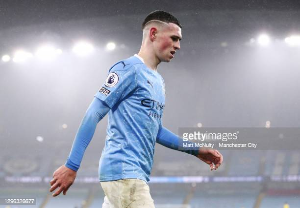 Phil Foden of Manchester City leaves the field as a subsitute during the Premier League match between Manchester City and Brighton & Hove Albion at...