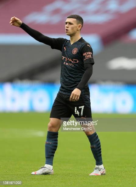 Phil Foden of Manchester City looks on during the Premier League match between West Ham United and Manchester City at London Stadium on October 24...