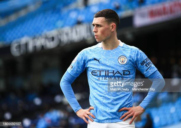 Phil Foden of Manchester City looks on during the Premier League match between Manchester City and West Ham United at Etihad Stadium on February 27,...
