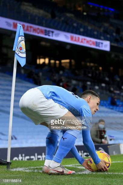 Phil Foden of Manchester City prepares to take a corner during the Premier League match between Manchester City and Tottenham Hotspur at Etihad...