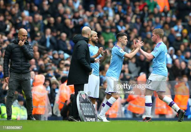 Phil Foden of Manchester City replaces Kevin De Bruyne of Manchester City during the Premier League match between Manchester City and Aston Villa at...