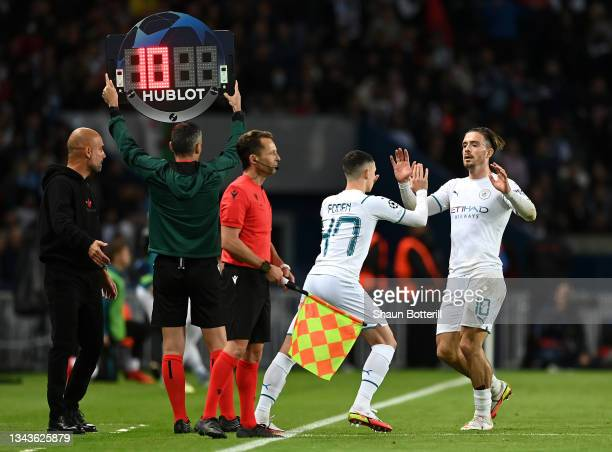 Phil Foden of Manchester City replaces teammate Jack Grealish during the UEFA Champions League group A match between Paris Saint-Germain and...