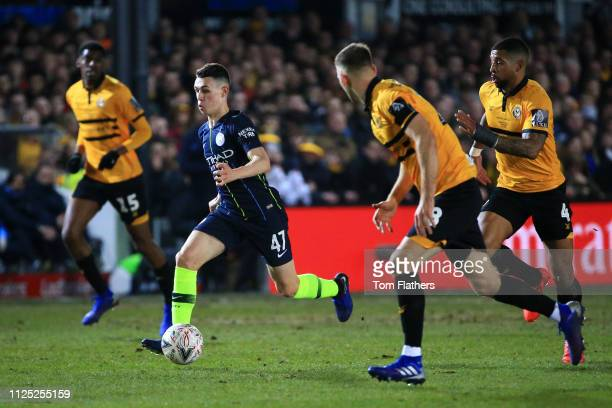 Phil Foden of Manchester City runs with the ball during the FA Cup Fifth Round match between Newport County AFC and Manchester City at Rodney Parade...