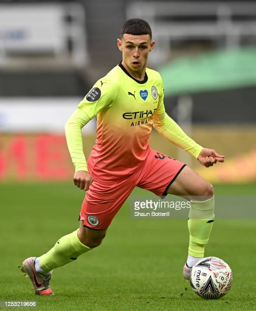 Phil Foden of Manchester City runs with the ball during the FA Cup Quarter Final match between Newcastle United and Manchester City at St James Park...