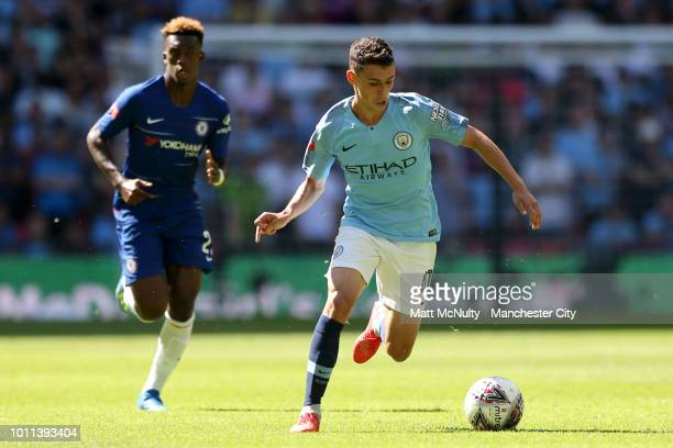Phil Foden of Manchester City runs with the ball during the FA Community Shield between Manchester City and Chelsea at Wembley Stadium on August 5...
