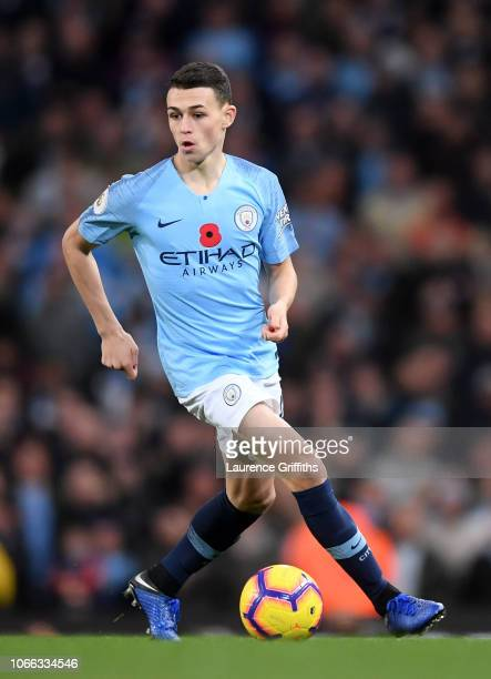 Phil Foden of Manchester City runs with the ball during the Premier League match between Manchester City and Manchester United at Etihad Stadium on...