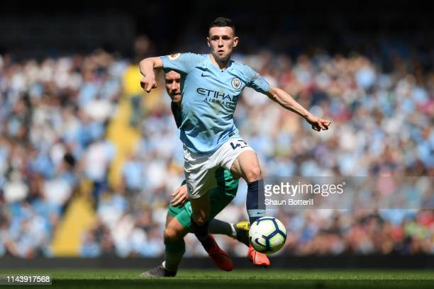 Phil Foden of Manchester City runs with the ball during the Premier League match between Manchester City and Tottenham Hotspur at Etihad Stadium on...