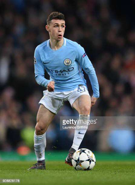 Phil Foden of Manchester City runs with the ball during the UEFA Champions League Round of 16 Second Leg match between Manchester City and FC Basel...