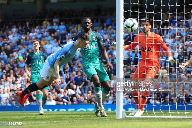 Phil Foden of Manchester City scores his team's first goal during the Premier League match between Manchester City and Tottenham Hotspur at Etihad...