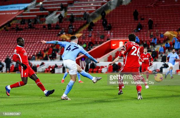 Phil Foden of Manchester City scores his teams fourth goal during the Premier League match between Liverpool and Manchester City at Anfield on...