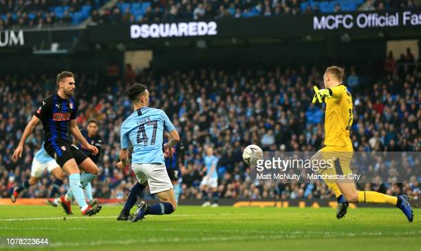 Phil Foden of Manchester City scores his team's second goal during the FA Cup Third Round match between Manchester City and Rotherham United at the...