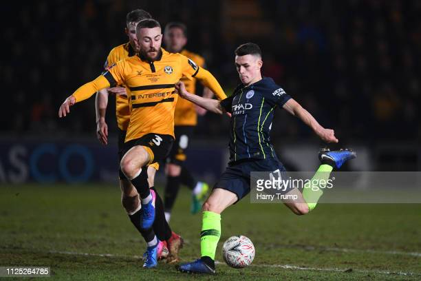 Phil Foden of Manchester City scores his team's third goal during the FA Cup Fifth Round match between Newport County AFC and Manchester City at...