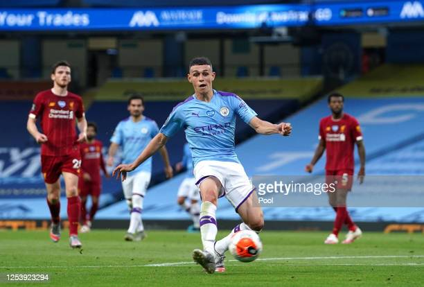 Phil Foden of Manchester City scores his team's third goal during the Premier League match between Manchester City and Liverpool FC at Etihad Stadium...