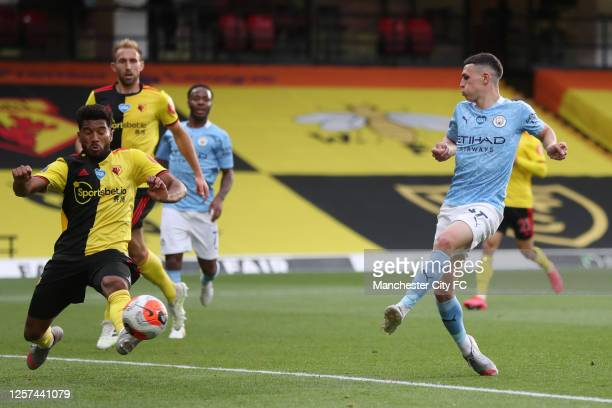 Phil Foden of Manchester City scores his teams third goal during the Premier League match between Watford FC and Manchester City at Vicarage Road on...
