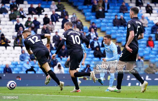 Phil Foden of Manchester City scores his team's third goal during the Premier League match between Manchester City and Everton at Etihad Stadium on...