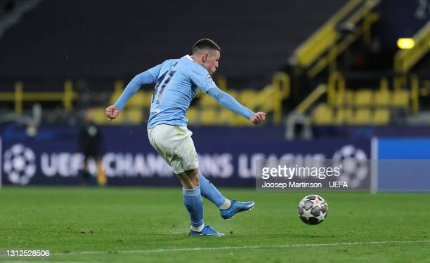 Phil Foden of Manchester City scores their side's second goal during the UEFA Champions League Quarter Final Second Leg match between Borussia...